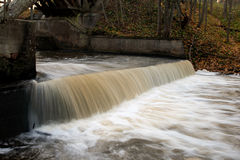 Small waterfall in the river. Forest river in autumn evening Royalty Free Stock Photography