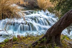 Small waterfall on river Krka. One of many waterfalls on the river Krka that are part of national park. Naturally formed. Photo taken in spring 2017 Royalty Free Stock Photos
