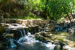 A small waterfall on the river on a sunny day in Rhodes in Greece stock photos