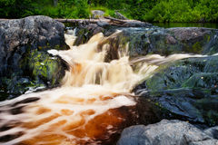 Small waterfall and rock in forest in Karelia Stock Photos