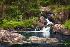 Small waterfall and rock in forest in Karelia Royalty Free Stock Photography