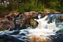 Small waterfall and rock in forest in Karelia Stock Photography