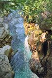 Small Waterfall into Rockpool at Velika Korita, Slovenia Royalty Free Stock Images