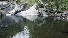 Small waterfall, rocks and poddle. Small waterfall, rocks and poddle with reflection HD footage stock video footage