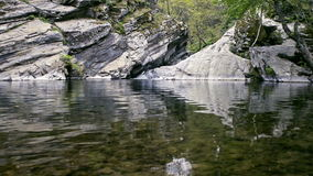 Small waterfall, rocks and poddle. Small waterfall, rocks and poddle with reflection HD footage stock video