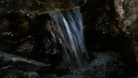 Small waterfall in rocky mountain. Water flowing down in rocky path. 4K. Small waterfall in rocky mountain. Water flowing down in rocky path stock video