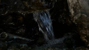 Small waterfall in rocky mountain. Water flowing down in rocky path. slow motion. Small waterfall in rocky mountain. Water flowing down in rocky path stock video footage