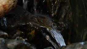 Small waterfall in rocky mountain. Water flowing down in rocky path. slow motion. Small waterfall in rocky mountain. Water flowing down in rocky path stock footage