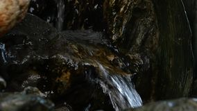 Small waterfall in rocky mountain. Water flowing down in rocky path. slow motion. Small waterfall in rocky mountain. Water flowing down in rocky path stock video