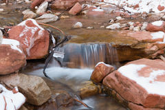 Small Waterfall in Snowy Creek Stock Photo