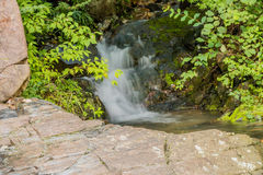 Small waterfall in steam in public park Royalty Free Stock Photos