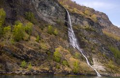 A small waterfall from a steep cliff stock photos