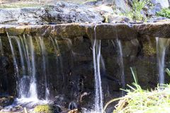 Small waterfall of a stream Royalty Free Stock Photos