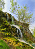 Small waterfall on a summer day Stock Image
