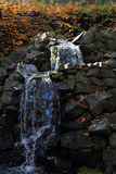 Small waterfall in the sun light Royalty Free Stock Photography