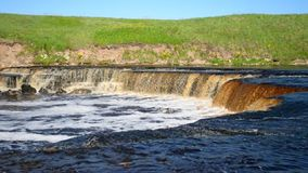 Small waterfall at sunny day. stock video footage