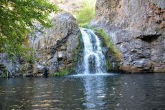 Small waterfall with swimming hole below Stock Photography