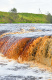 Small waterfall on Tosna River. Stock Photos