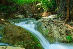 Waterfall in tropical deep forest at Erawan National Park Royalty Free Stock Images