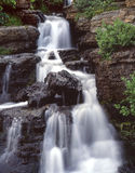 Small Waterfall (V). A small waterfall along the Going to the Sun Road in Montana's Glacier National Park Royalty Free Stock Image