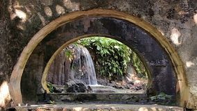 Small Waterfall Viewed Through An Old Building. San Luis Potosi, Mexico. stock footage
