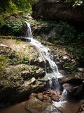 A small waterfall. Water falling from a hill royalty free stock photography