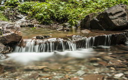 Small waterfall. Water stream in the mountains Royalty Free Stock Photography