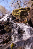 Small waterfall on Watkin path. On the lower stretch of the Watkin path up to Snowdon is this small but wonderful waterfall coming down from above Royalty Free Stock Photo