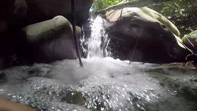 A small waterfall in the wild jungle . Philippines. Palawan Island stock video