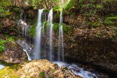 Small waterfalll in Val di Fassa Royalty Free Stock Image