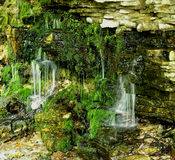 Small waterfalls. Formed with the time in Niagara Escarpment Royalty Free Stock Photo