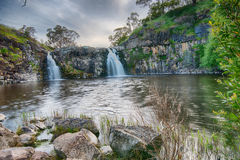 Small waterfalls with green background Royalty Free Stock Photo