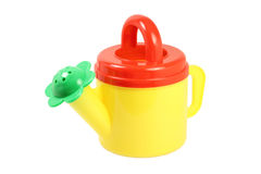 Small watering can watering flowers Royalty Free Stock Photography