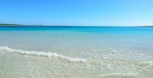 Small wave in La Pelosa beach. Sardinia Royalty Free Stock Image