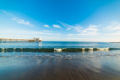 Small wave by the pier in Malibu beach. Los Angeles, California Stock Photo