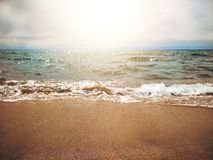 Small wave. On a sunny day by the sea royalty free stock photo
