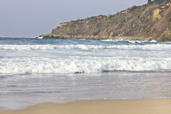 Small waves at the beach Royalty Free Stock Images