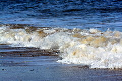 Small Waves crashing onto shore near Bridlington stock images