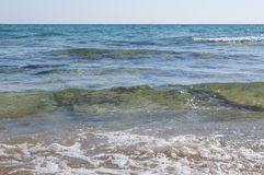 Small waves in crystal blue sea Royalty Free Stock Image