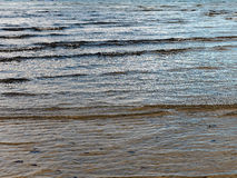 Small Waves on Sandy Beach Stock Images