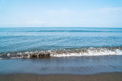 Small waves on the sea coast, beautiful blue sea landscape Royalty Free Stock Photo