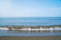 Small waves on the sea coast, beautiful blue sea landscape Royalty Free Stock Image