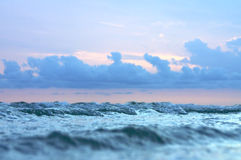 Small waves and stormy sky Stock Photo