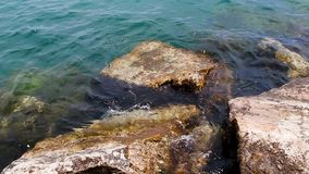 Small Waves Washing Over Rocks On Edge Of Jetty Lake Michigan stock video