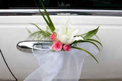 Small wedding bouquet. On the car Stock Photos