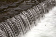 Small weir on riverine Royalty Free Stock Images