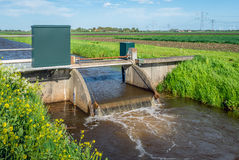 Small weir for water level control from close stock photo