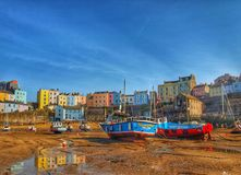 A small Welsh fishing harbour at low tide royalty free stock photo