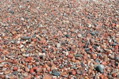 Small Wet Pebbles Seaside Stock Photo
