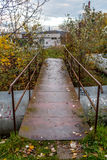 Small wet steal bridge over city heating tubes Royalty Free Stock Photos